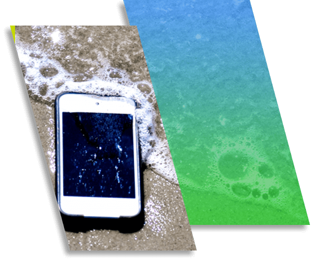 Image of an iPhone on the beach, covered in water.