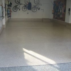 Large garage with epoxy floor by FloorEver Solutions