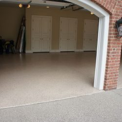 Interior garage epoxy flooring by FloorEver Solutions