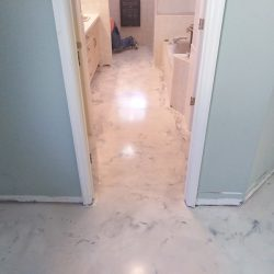 Metallic Epoxy in master bathroom by FloorEver Solutions