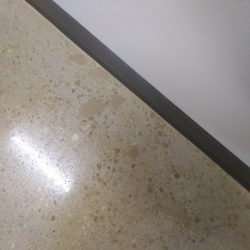 Polished concrete with brown details by FloorEver Solutions