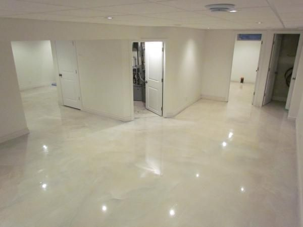 Marble Metallic Epoxy Flooring With A Clear Urethane Top Coat.
