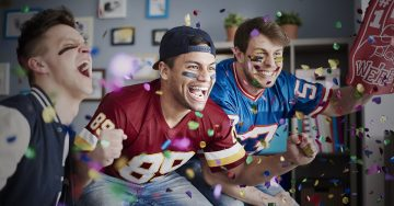 picture of sports fans watching tv