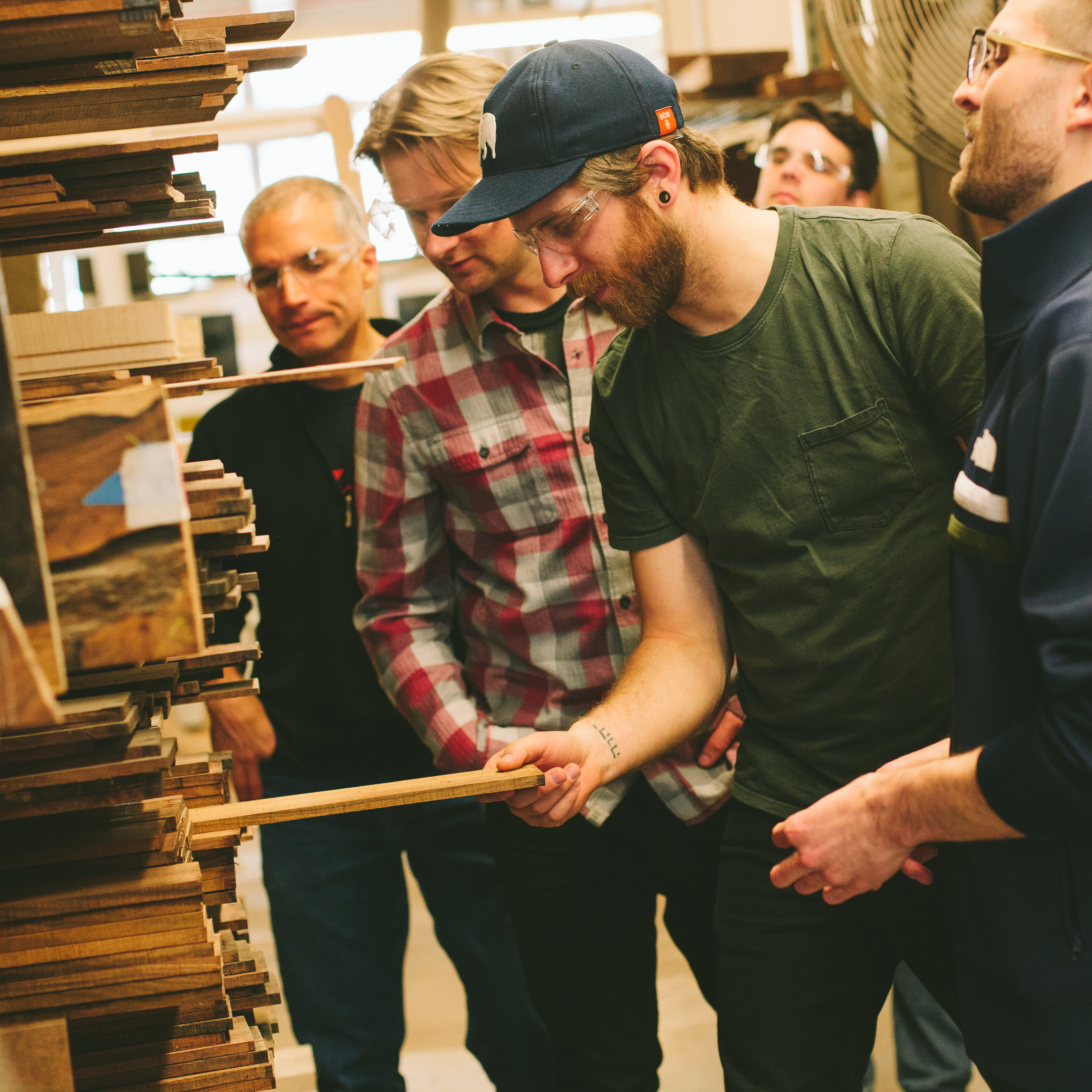 Luthiers Examining Guitar Woods