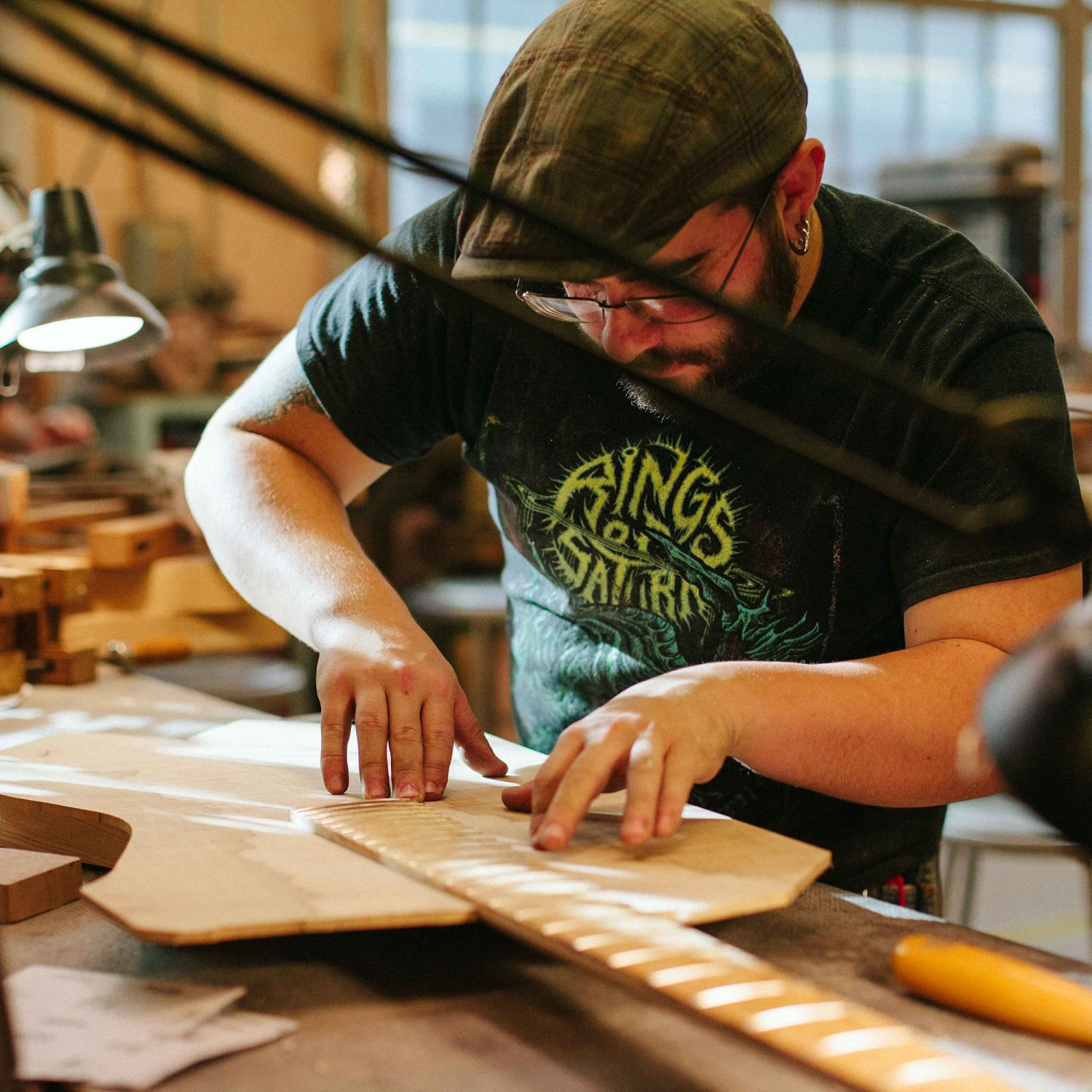 Luthier Working on a Guitar Neck