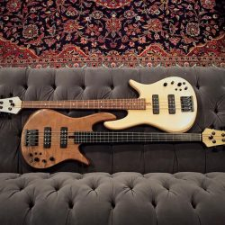 Two Custom Basses on Couch