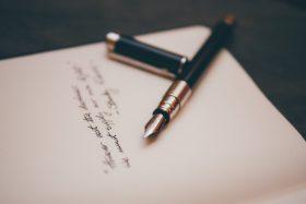 Pen resting on paper