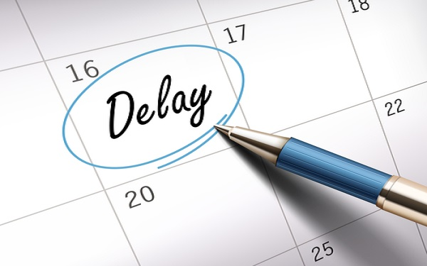delay word circle marked on a calendar by a blue ballpoint pen. 3D illustration
