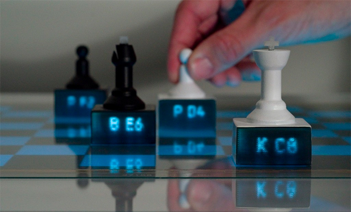 3D printed chess pieces with light pipes on an interactive tabletop that suggest your next move