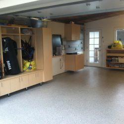 Sports equipment lockers in garage space. Garage epoxy floor coating