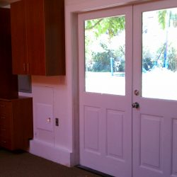 Garage office with storage and wooden cabinets