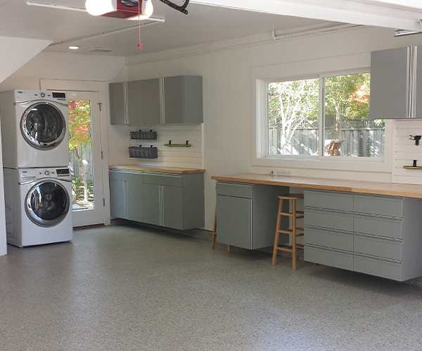 Image of custom stainless steel cabinets from Beautiful Garage.