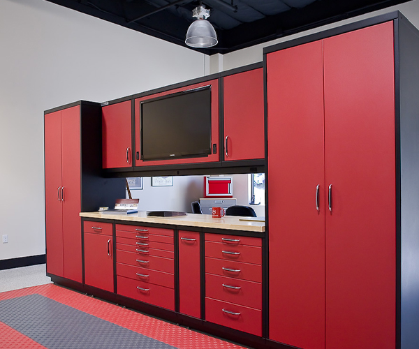 Image of red steel cabinets by Beautiful Garage.