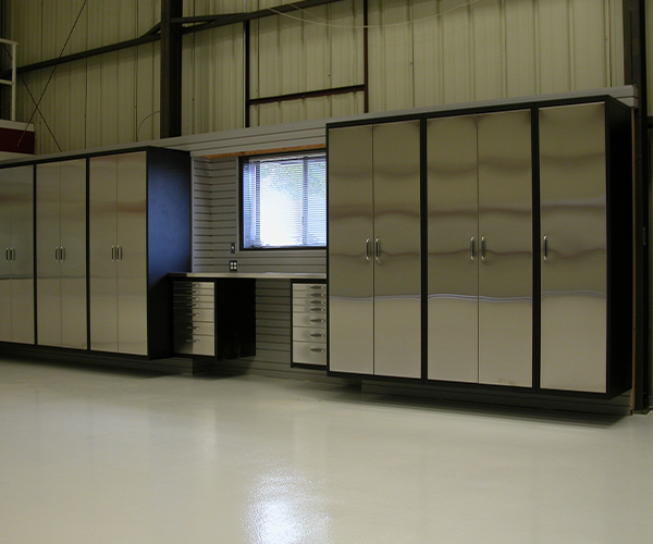 Image of large stainless steel garage cabinets by Beautiful Garage.