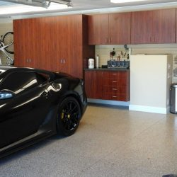 Wooden garage cabinets in a workstation with epoxy floor coating; San Francisco