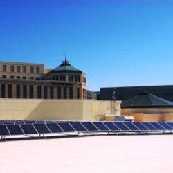 Row of commercial solar panels on top of Clark Planetarium - Gardner Energy