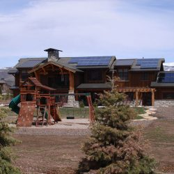Home with playground and solar panels installed on the roof - Gardner Energy
