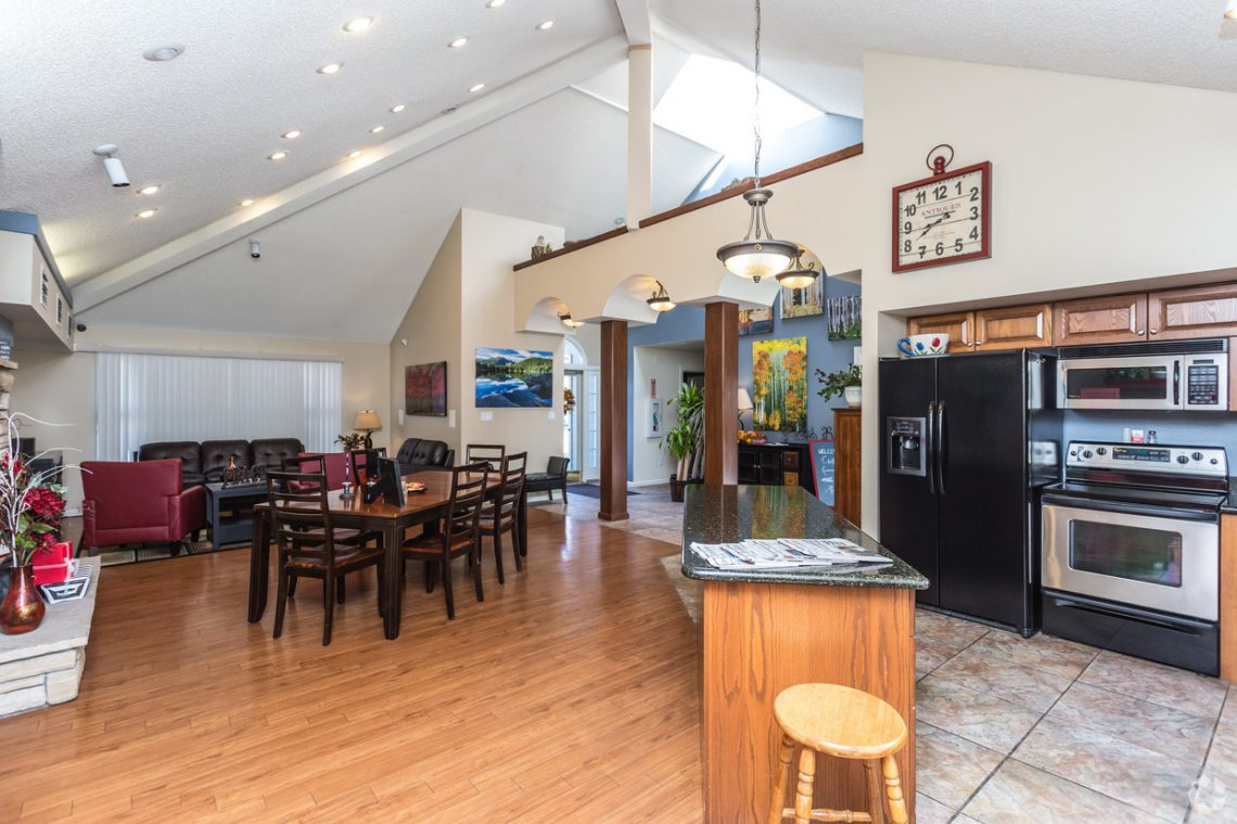 Our open clubhouse with kitchen, dining and living area, and games - Gateway Place Apartments