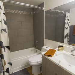 An updated apartment bathroom - Gateway Place Apartments