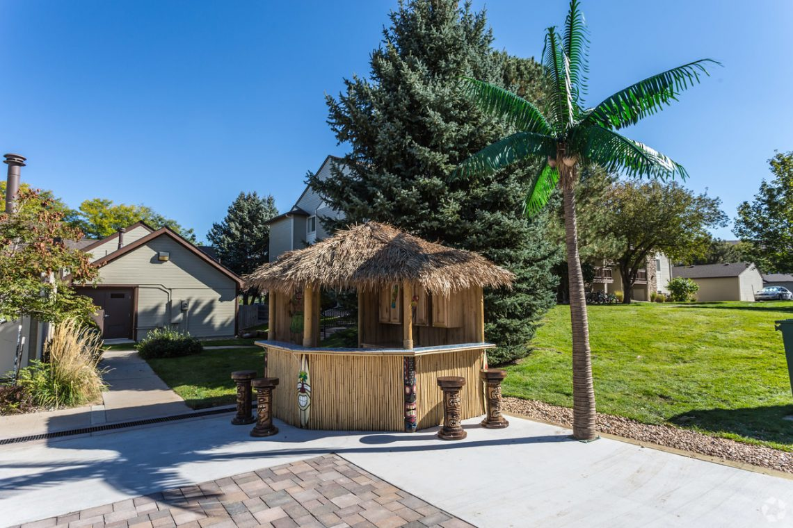 Tiki hut bar on the grounds at Gateway Place Apartments