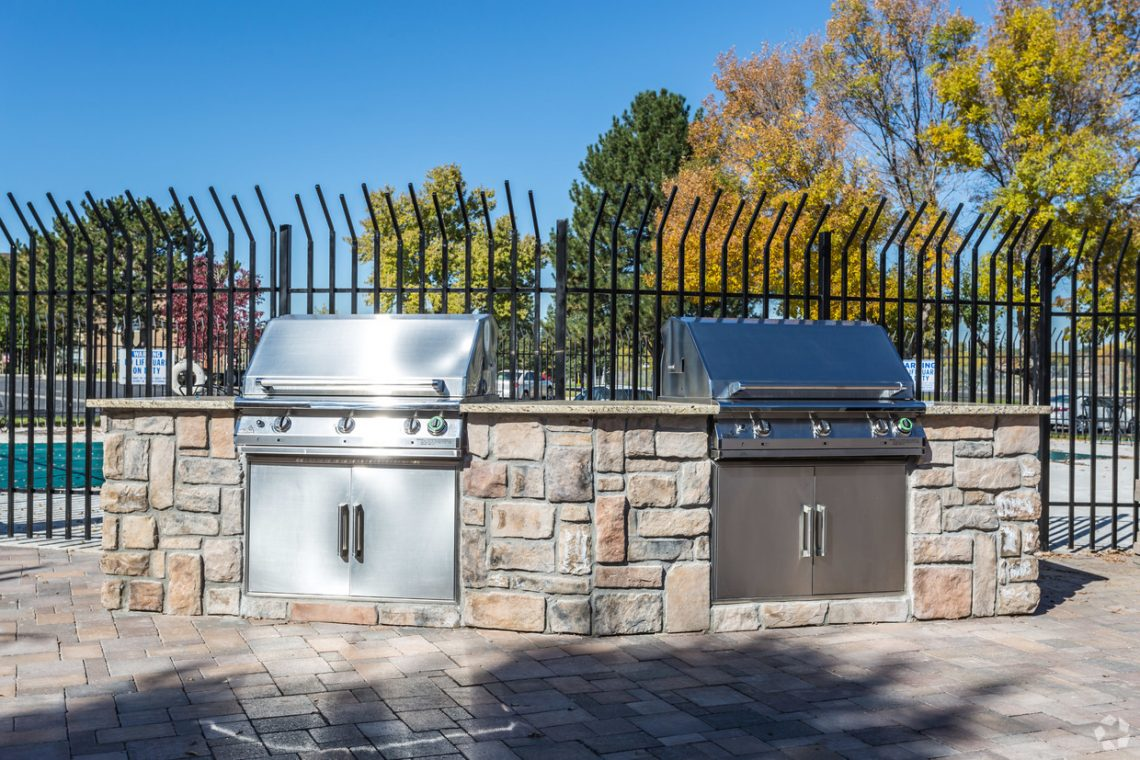 The outdoor kitchen with BBQs at Gateway Place Apartments
