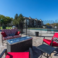An outdoor seating area with gas fireplace at Gateway Place Apartments