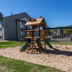 A playground with sand floor on the grounds of Gateway Place Apartments
