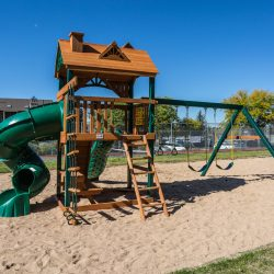 A large playground with slide, climbing rope, and more at Gateway Place Apartments