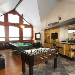 The clubhouse at Gateway Place Apartments with foosball, pool table, and bar