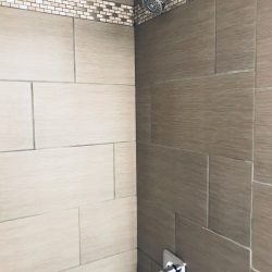 Updated apartment bathroom shower with tile - Gateway Place Apartments