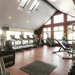 Our large fitness center with treadmills, freeweights, and more - Gateway Place Apartments