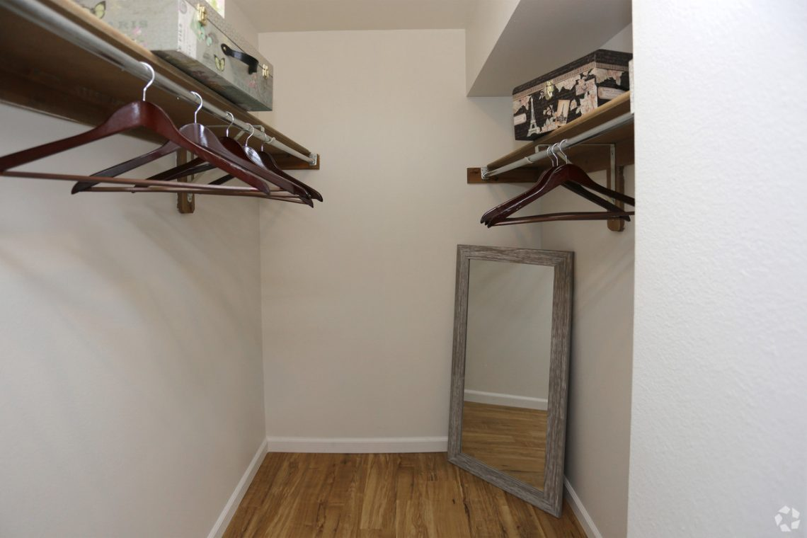 A large walk-in closet at our Gateway Place Apartments