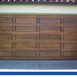 Multi-paneled wooden full length door from G&G Garage Door