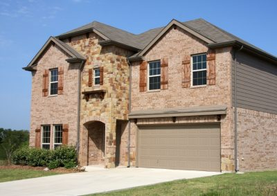 Accent your brick home with a door from G&G Garage door.