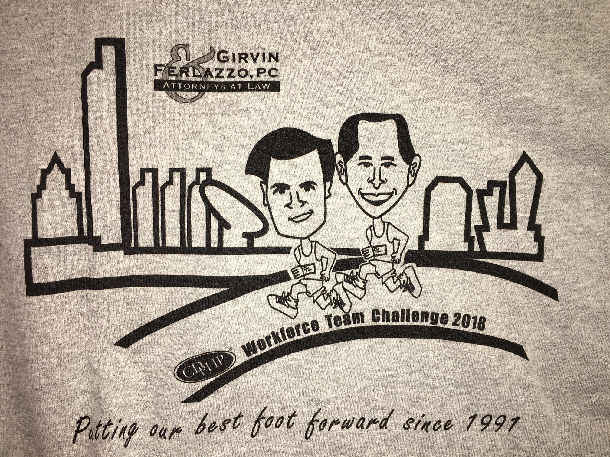 "A t-shirt designed by a Girvin & Ferlazzo legal assistant reads, ""putting our best foot forward since 1991"""