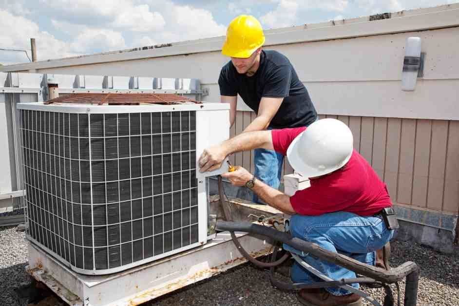 Two men conducting maintenance on HVAC system outside
