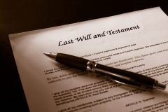 pen on top of last will and testament document
