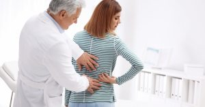 image of a chiropractor examining a woman's back
