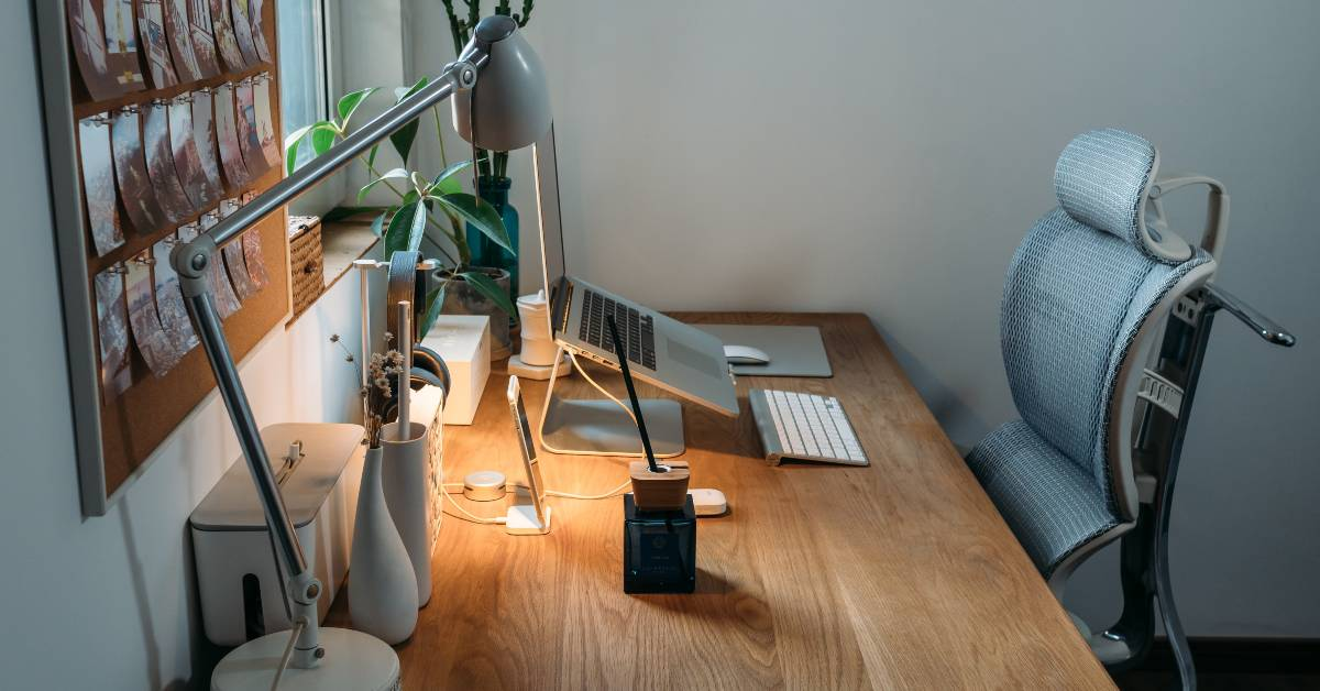 Photo of a desk with chair and computerby Samule Sun on Unsplash
