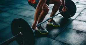 Photo of a person about to lift a barbell by Victor Freitas on Unsplash