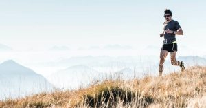 Photo of man running in mountains by asoggetti on Unsplash