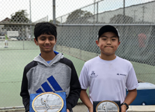 Image of two young boys with tennis plaques