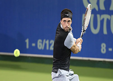 Image of professional tennis player about to backhand the ball