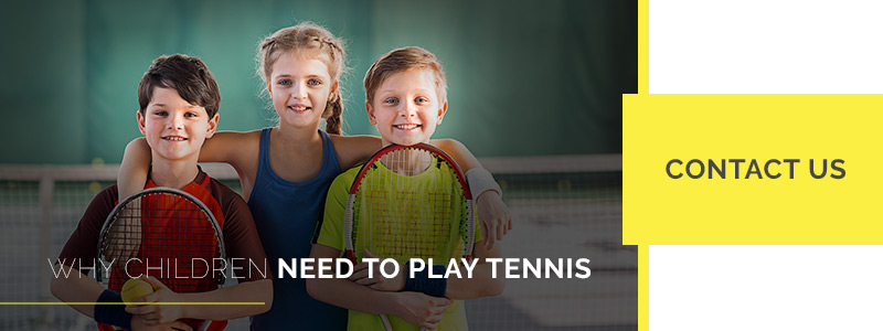 Image of three kids embracing with tennis rackets and smiles