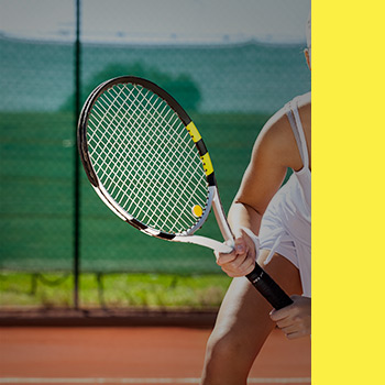 Image of Tennis racket held with a woman's confidence