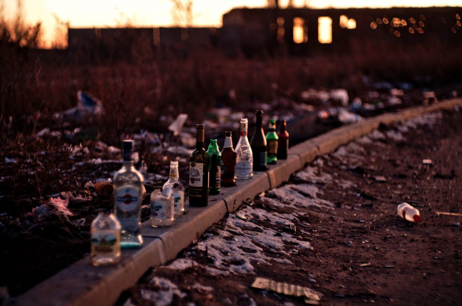 An image of alcohol bottles on the ground.