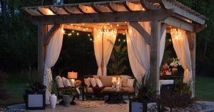 patio with pergola and stringed lights at nighttime