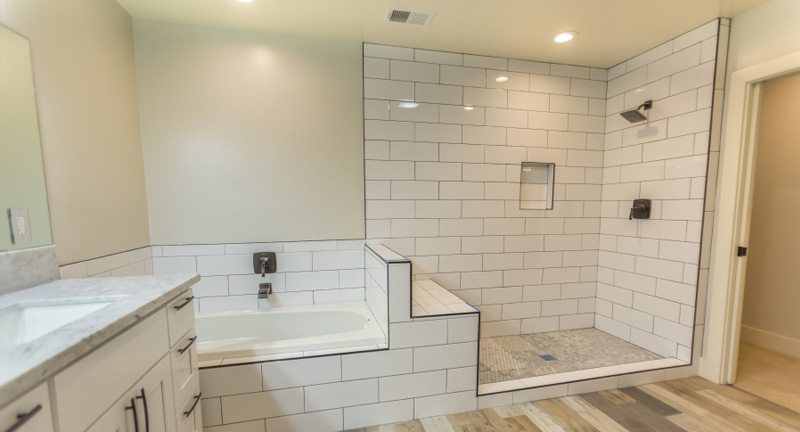 Bathroom With White Tile Shower and Tub