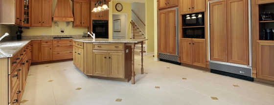Kitchen With Tile Floor and Walnut Cabinetry