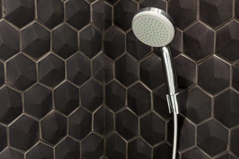 Shower With Black Hexagonal Tile